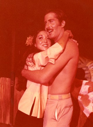 """Photo of Susie Zaguirra and Gary Brunson on stage in """"South Pacific,"""""""